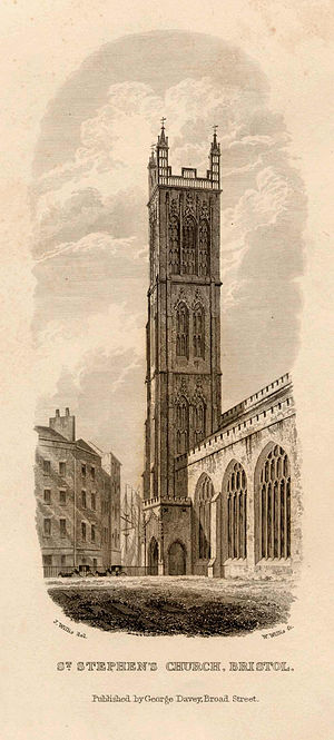 St Stephen's Church, Bristol - Black and white engraving of St Stephen's Church, Bristol, UK, published c.1838. The view is from the south east of the church, showing the body of the church on the right of the image and the distinctive tall, thin tower in the centre. In front of the church can be seen two horses and carts.  From 1240 to 1892 the Bristol Harbour was on the opposite side of the church when it was filled in.