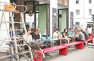 Cafe customers in Berlin Mitte using Wi-Fi devices St oberholz.jpg
