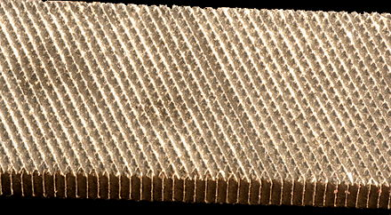 A file is an abrasive surface like this one that allows machinists to remove small, imprecise amounts of metal. Surface of a file.jpg