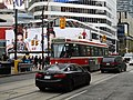 TTC streetcar visible by Dundas Square, 2015 12 01 (7) (23112003349).jpg