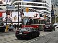 TTC streetcar visible by Dundas Square, 2015 12 01 (7) (23112003349).jpg