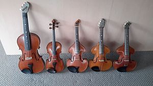 Tenor violin - Four 120-year-old tenor violins with a full-size standard violin second from left for size reference.