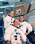 The Apollo 12 crew poses on the ladder of a LM mockup.jpg