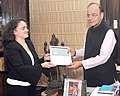 The Asian Editor of the Banker Magazine, Ms. Spesania Palma presents to the Union Minister for Finance and Corporate Affairs, Shri Arun Jaitley for the Best Finance Minister Award of Global as well as Asia Pacific.jpg