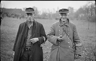Volkssturm - Two members of the Volkssturm surrender to British troops near Bocholt, 28 March 1945.