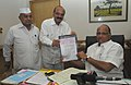 The Chairman, NCCF, Shri Virendra Singh presenting a dividend cheque to the Union Minister for Consumer Affairs, Food and Public Distribution and Agriculture, Shri Sharad Pawar, in New Delhi on August 19, 2010.jpg