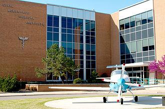 Civil Aerospace Medical Institute -  The Civil Aerospace Medical Institute building, showing the prior static display aircraft a Lancair Tigress with Orenda V8 Lancair Tigress