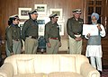 The DG, Central Reserve Police Force (CRPF), Shri J.K. Sinha presenting a cheque of Rs. 4.4 crore to the Prime Minister, Dr. Manmohan Singh, towards the Prime Minister's National Relief Fund in New Delhi on December 29, 2004.jpg