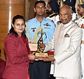 The President, Shri Ram Nath Kovind presenting the Arjuna Award, 2018 to Ms. Pooja Kadian for Wushu, in a glittering ceremony, at Rashtrapati Bhavan, in New Delhi on September 25, 2018.JPG