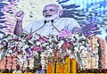 The Prime Minister, Shri Narendra Modi addressing at Foundation Stones laying ceremony of the Greenfield Airport for Rajkot and other road development projects, at Chotila, Gujarat.jpg