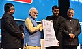 The Prime Minister, Shri Narendra Modi awards the District Collectors who transformed the most backward districts to adopt digital payments, at the DigiDhan Mela, in New Delhi (1).jpg