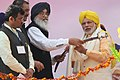 The Prime Minister, Shri Narendra Modi being presented a sword by the Chief Minister of Punjab, Shri Parkash Singh Badal, at National Martyrs Memorial, in Hussainiwala, Firozpur, Punjab on March 23, 2015.jpg