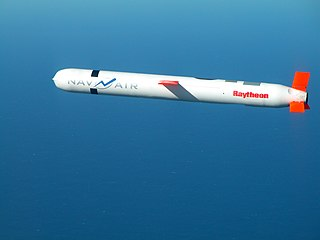 A cruise missile labelled with the Raytheon logo soars through the air