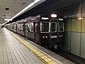 Train for Tengachaya Station arriving at Ebisucho Station 2.jpg