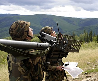Red Flag – Alaska - JASDF soldiers hunt for mock enemy aircraft at Eielson Air Force Base, Alaska as part of Red-Flag Alaska. They are armed with a Type 91 Kai MANPAD.