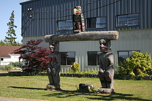 Fort Rupert - A welcome pole in front of U'gwamalis Hall, the Band Office for the Kwakiutl First Nation.