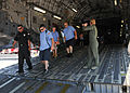 U.S. Air Force Capt. Tammy Ostrowski, right, directs emergency services personnel as they transport mock victims from a C-17 Globemaster III aircraft to a triage area during exercise Golden Eagle III at Stewart 130601-Z-VX101-023.jpg