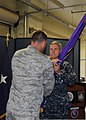 U.S. Air Force Col. Rick Watson, left, passes the guidon to Navy Rear Adm. Scott Stearney, commander of the Joint Enabling Capabilities Command, during the Joint Planning Support Element's change of command 130628-D-EW431-557.jpg