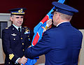 U.S. Air Force Maj. Gen. Andrew Mueller, right, commander of the E-3A Component, hands Italian air force Col. Arturo Di Martino, left, the unit guidon during a change of command ceremony for the Training Wing 130920-F-WP626-966.jpg