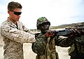 U.S. Marine Corps Cpl. John P. Maggard, a range coach with the 3rd Battalion, 25th Marine Regiment, inspects the chamber of a Gambian soldier's rifle during combat marksmanship training July 15, 2012, in Thies 120715-M-XI134-1660.jpg