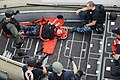 U.S. Sailors assigned to the visit, board, search and seizure team aboard the littoral combat ship USS Freedom (LCS 1) learn how to prepare a stretcher-bound patient for medical evacuation during a training 130528-N-PD773-259.jpg