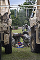 U.S. Soldiers assigned to the 108th Chemical Company, South Carolina Army National Guard, monitor a simulated casualty during a mass decontamination exercise during Ardent Sentry, held in Varnville, S.C 130518-Z-DH163-025.jpg