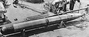 Bliss-Leavitt torpedo - US 21-inch torpedo (probably Bliss-Leavitt Mark7 or Mark8) being loaded onto USS Oklahoma, ca. 1919