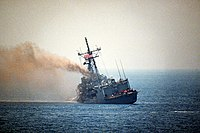 The damaged US Frigate, USS Stark, after being struck by an Iraqi Exocet Missile in the Persian Gulf.