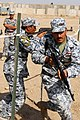 """US Army 53728 BAGHDAD - Iraqi Federal Policemen of 1st Battalion, 2nd FP Brigade, storm a """"glass house"""" at Joint Security Station Istaqlal, here, Oct. 19.jpg"""