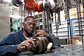 US Navy 030306-N-5362F-001 Airman Nathaniel Holmes Jr. from Chicago, Ill., conducts maintenance on a catapult hydraulic valve aboard USS Abraham Lincoln (CVN 72).jpg