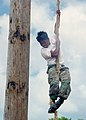 US Navy 030721-N-1212B-001 Sea Cadet Alfie Sumulat assigned to Battleship Missouri Division Sea Cadets, receives instructions while climbing a 25-foot rope at the finish of a confidence course at Marine Corps Base, Kaneohe Bay.jpg
