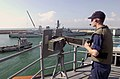 US Navy 031014-N-1056B-001 orpedoman Robert Allen mans a .50 cal. gun mount aboard the guided missile frigate USS Nicholas (FFG 47) as the ship departs Naval Station Rota, Spain.jpg