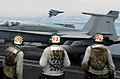 US Navy 040628-N-6213R-061 Flight deck personnel look on as an F-14D Tomcat performs a high-speed fly-by.jpg