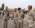 US Navy 041126-M-8096K-010 Secretary of the Navy (SECNAV), Gordon England, visits Camp Fallujah, Iraq, thanking Sailors and Marines for their hard work and dedication during the holidays.jpg