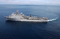 US Navy 050117-F-4884R-015 he amphibious dock landing ship USS Fort McHenry (LSD 43) makes a wide turn prior to conducting helicopter operations off the coast of the island of Sumatra, Indonesia.jpg