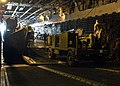 US Navy 050203-N-6920A-001 Seabees, assigned to Naval Mobile Construction Battalion One (NMCB-1), load machinery equipment onto a Landing Craft Unit (LCU) in the well deck aboard the amphibious assault ship USS Saipan (LHA 2).jpg