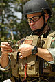 US Navy 050312-N-5781F-002 Aviation Ordnanceman 1st Class Brian Fitzgerald, assigned to Explosive Ordnance Disposal Mobile Unit Five (EODMU-5), studies his compass at a land navigation training exercise.jpg