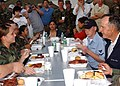 US Navy 051008-N-8253M-003 After arriving on board Naval Air Station Joint Reserve Base (NAS JRB), New Orleans, former President George H. Bush sits down to eat with military personnel.jpg