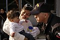 US Navy 051212-N-8854R-093 Aviation Support Equipment Technician 2nd Class Carlos Diaz greets his wife and baby girl in Yokosuka, Japan, after a seven-week deployment aboard the conventionally powered aircraft carrier USS Kitty.jpg
