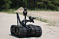 US Navy 060607-N-7987M-025 Explosive Ordnance Disposal Training and Evaluation Unit Two (EODTEU-2) demonstrates the use of a robot to disarm and defeat improvised explosive devices (IEDs) during a media demonstration at Fort St.jpg