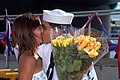 US Navy 070828-N-5476H-024 Culinary Specialist 3rd Class David Quintero greets his wife with the ceremonial first kiss as Los Angeles-class attack submarine USS Key West (SSN 722) returns home.jpg