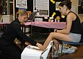 US Navy 071010-N-7157V-001 Hospital Corpsman 3rd Class Katelyn Wisnoski, assigned to Naval Hospital Bremerton, performs a bone density test at a Breast Cancer Awareness Event at Bangor Fitness Center.jpg