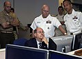 US Navy 080626-N-0659H-013 Secretary of the Navy Donald C. Winter studies a Sailors career information while Rear Adm. Sonny Masso, commander of Navy Personnnel Command (NPC), explains the reviewing process.jpg