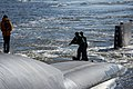 US Navy 081124-N-1841C-067 Crewmembers from USS Georgia (SSGN 729) haul on a line.jpg
