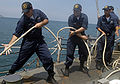 US Navy 090824-N-4879G-290 Sailors pull in the aft mooring line during a berthing shift aboard the guided-missile frigate USS Doyle (FFG 39).jpg