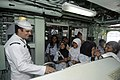 US Navy 100225-N-8335D-352 Mineman 2nd Class Zachary Sund gives a tour of the bridge of the mine counter-measures ship USS Patriot (MCM 7).jpg