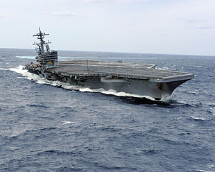 US Navy 100227-N-1854W-716 USS George H.W. Bush (CVN 77) heels hard to starboard during high-speed drills.jpg
