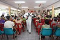 US Navy 100421-N-9719T-337 Musician 3rd Class Charles Perkes, a member of the U.S. 7th Fleet ensemble band, Far East Edition, sings for the residents of the Elderly Age Home Banglamung in Chonburi, Thailand.jpg