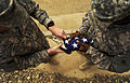 US Navy 100430-N-7130B-148 Service members assigned to Special Operations Task Force West fold an American flag during a memorial marking the anniversary of the death of Explosive Ordnance Disposal Technician 2nd Class Tyler Tr.jpg