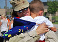US Navy 100721-N-7084M-876 A Sailor is greeted by her son after returning from a five-month deployment.jpg